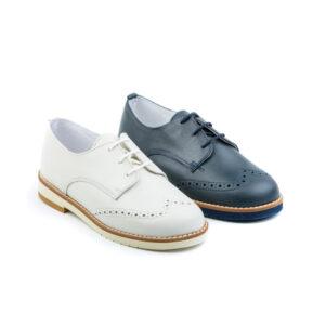 zapato comunión en piel napa en color marino y porcelana