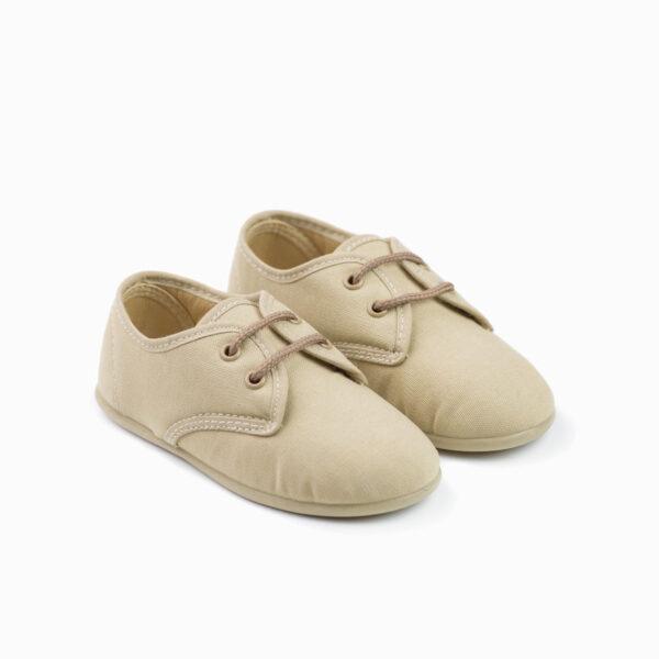 zapato de lona beige con cordones
