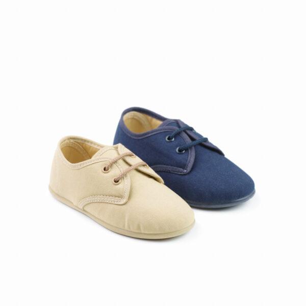 zapato de lona tipo blucher para niño con cordones marino y beige